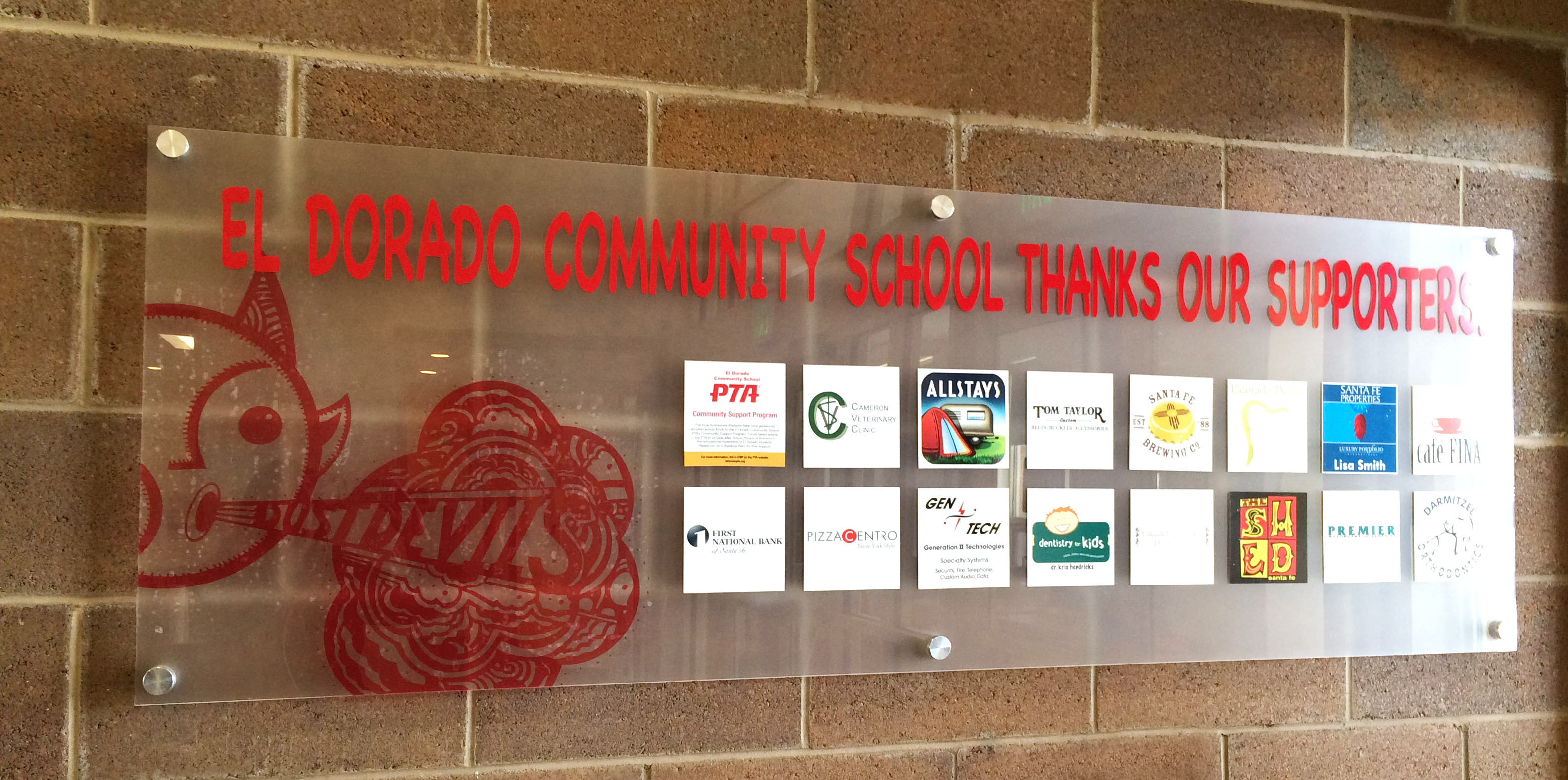 Eldorado Community Schools Community Support thank you board with the logos of corporate sponsors